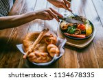 a hands with fork and knife... | Shutterstock . vector #1134678335