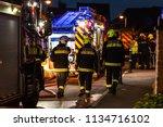 fire brigade in action fighting ... | Shutterstock . vector #1134716102