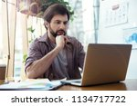 man sitting at the table at... | Shutterstock . vector #1134717722