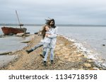 mom and dauther  have a fun on... | Shutterstock . vector #1134718598