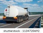fuel truck rides on highway ... | Shutterstock . vector #1134720692