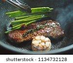 cooking pan seared top sirloin... | Shutterstock . vector #1134732128