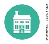 two storey house icon in badge... | Shutterstock . vector #1134757325