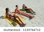 women relaxing on beach with... | Shutterstock . vector #1134766712