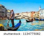 venice  italy. gondolier... | Shutterstock . vector #1134775082