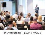 speaker giving a talk in...   Shutterstock . vector #1134779378
