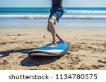 young man surfer training... | Shutterstock . vector #1134780575