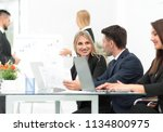 business team discussing new... | Shutterstock . vector #1134800975