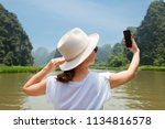 young woman traveling by boat... | Shutterstock . vector #1134816578