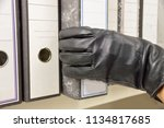 thief stealing ring binder and... | Shutterstock . vector #1134817685