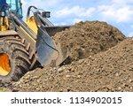 the bucket loader is repairing... | Shutterstock . vector #1134902015