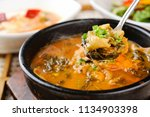 delicious loach soup in a bowl | Shutterstock . vector #1134903398