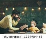knowledge concept. man teacher... | Shutterstock . vector #1134904466