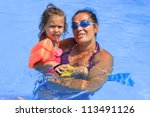 Mother and daughter in the swimming pool - stock photo
