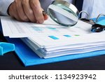 Small photo of Auditor is working with financial documents. Audit or assessments.