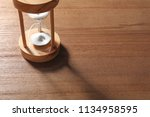 hourglass with flowing sand on... | Shutterstock . vector #1134958595