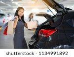 asian women keep shopping bags...   Shutterstock . vector #1134991892