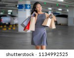 asian women are happy shopping...   Shutterstock . vector #1134992525
