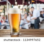 frosty glass of light beer on... | Shutterstock . vector #1134997652