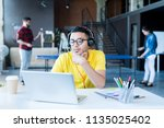 portrait of  creative young... | Shutterstock . vector #1135025402