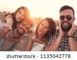 group of young friends having... | Shutterstock . vector #1135042778