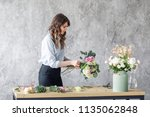 woman florist creating... | Shutterstock . vector #1135062848