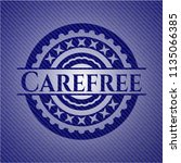 carefree badge with denim... | Shutterstock .eps vector #1135066385