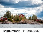 bright red houses on the rocks...   Shutterstock . vector #1135068332