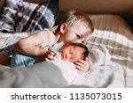 happy little brother with... | Shutterstock . vector #1135073015