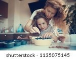 mother and daughter prepare a...   Shutterstock . vector #1135075145