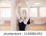 portrait of a young ballerina... | Shutterstock . vector #1135081352