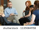 serious teacher talking to a... | Shutterstock . vector #1135084958