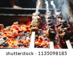 three shish kebabs are fried on ... | Shutterstock . vector #1135098185