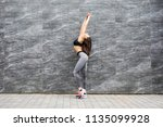 sporty beautiful young woman... | Shutterstock . vector #1135099928