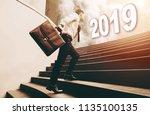 businessman holding briefcase... | Shutterstock . vector #1135100135