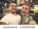 young  and happy couple is... | Shutterstock . vector #1135100168