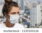 woman wearing face mask because ... | Shutterstock . vector #1135103126