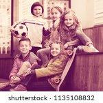 urban portrait of active junior ... | Shutterstock . vector #1135108832