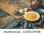 fall warming pumpkin cream soup ... | Shutterstock . vector #1135129448