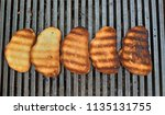 barbecue bread on the grill.... | Shutterstock . vector #1135131755