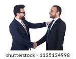 side shot of two employees... | Shutterstock . vector #1135134998