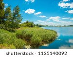 view of calm lake in summer | Shutterstock . vector #1135140092