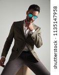 seductive man in green suit...   Shutterstock . vector #1135147958