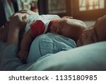 young mother with her newborn... | Shutterstock . vector #1135180985