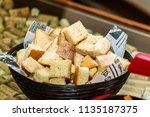 bread pieces in a bucket | Shutterstock . vector #1135187375