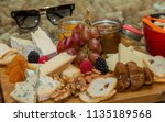 healthy cheese and fruits in a... | Shutterstock . vector #1135189568