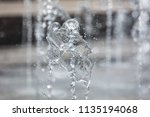 splashing water from a fountain ... | Shutterstock . vector #1135194068
