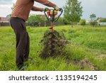 worker drills the ground at the ... | Shutterstock . vector #1135194245