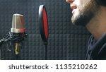 male singer in headphones... | Shutterstock . vector #1135210262