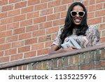 beautiful well dressed black...   Shutterstock . vector #1135225976